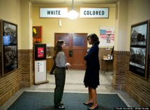 First Lady Michelle Obama tours the Brown v. Board of Education National Historic Site in Topeka, Kan., May 16, 2014. Stephanie Kyriazis, Chief of Interpretation and Education, leads the tour. (Official White House Photo by Chuck Kennedy) This official White House photograph is being made available only for publication by news organizations and/or for personal use printing by the subject(s) of the photograph. The photograph may not be manipulated in any way and may not be used in commercial or political materials, advertisements, emails, products, promotions that in any way suggests approval or endorsement of the President, the First Family, or the White House.